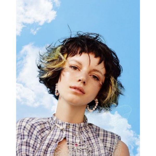 Short Curly Bob With Chopped Bangs Wih Blonde Highlights