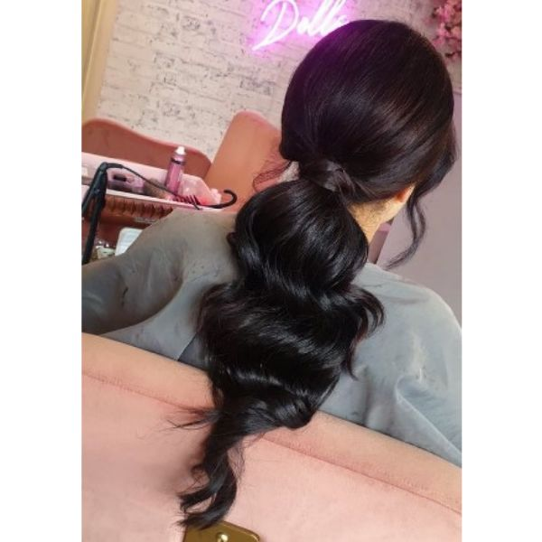 Wavy Low Ponytail With Falling Side Strands Hairstyle For Black Hair