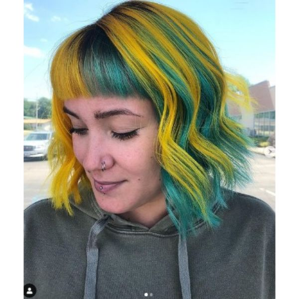 Yellow Teal Colored Curly Bob With Straight Bangs