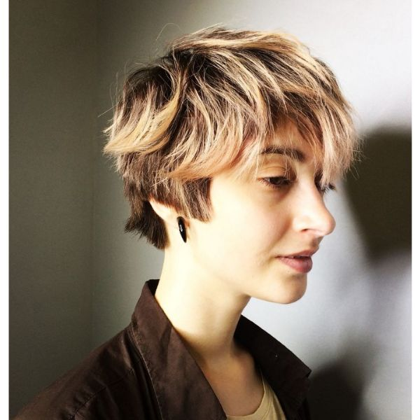 Short Layered Blonde Hairstyle With Messy Bangs